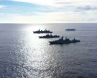 Russian Fleet Moves in on Hawaii, Practices Sinking Aircraft Carrier, US F-22 Stealth Fighters on Standby