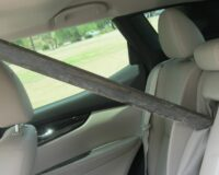 Woman Inches from Being Impaled When Metal Pole Flies Through Windshield on Highway